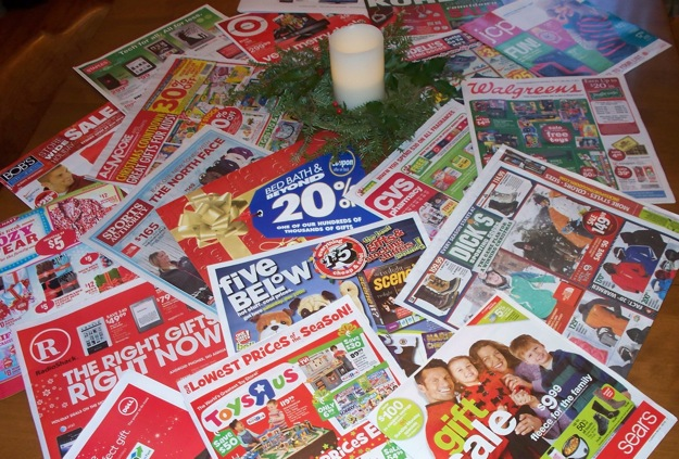 Christmas flyers spread on the table.
